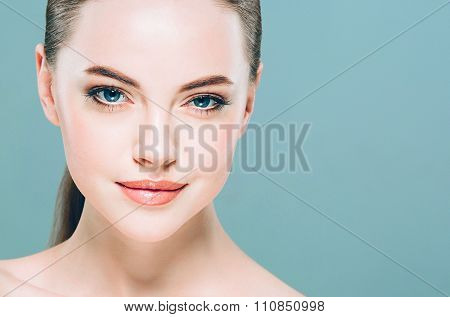 Beauty Woman Face Portrait. Beautiful Spa Model Girl With Perfect Fresh Clean Skin. Blue Background.