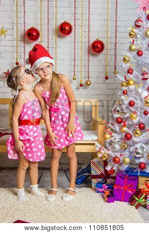Girl Whispers Something To The Other Girl Is In The Christmas Stop