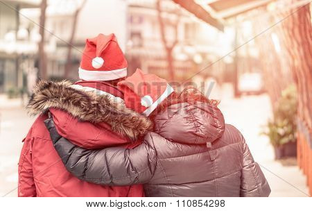 Young Couple hugging eachothers for Christmas time - Love and holidays concept