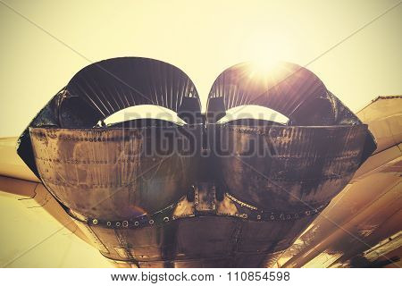 Retro Toned Jet Exhaust Pipes Against Sun