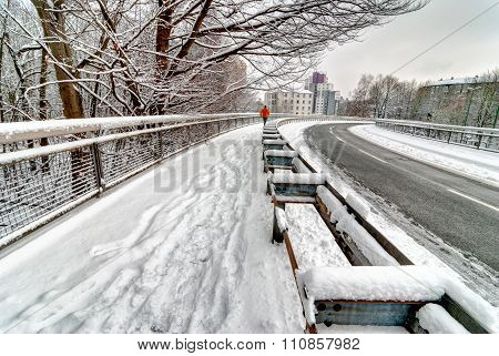 Jogger Running Along Curvy Snowy Road