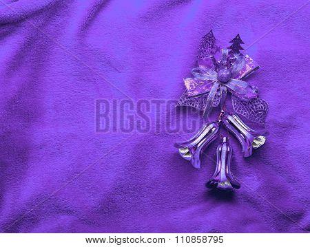 Xmas bells on violet background.