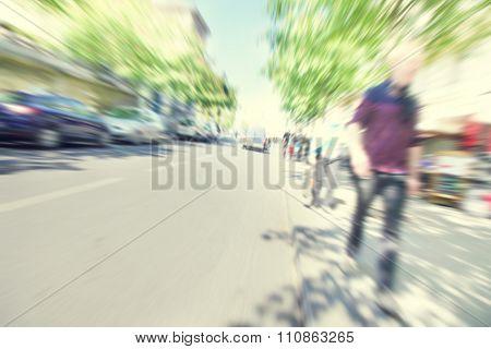 Motion blurred image of urban scene.