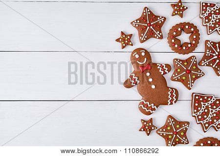 Gingerbread cookies christmas composition, with empty space for disign text on white wooden table ba