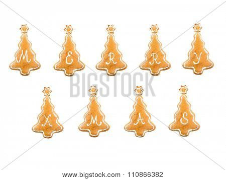Christmas tree-like gingerbread cookie with Merry Xmas spelling on white background
