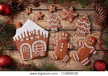 Gingerbread house, man and woman, fir trees, stars cookies christmas composition in new year decorat