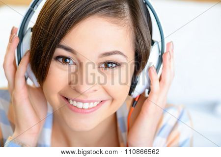 Teenage girl wearing headphones.