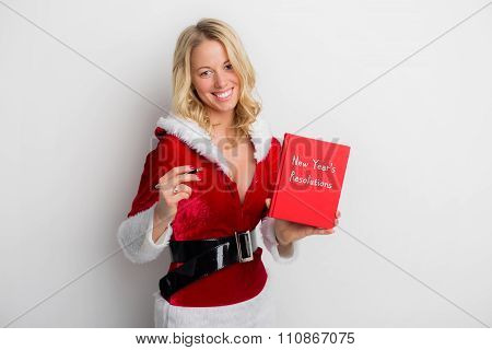 Woman holding New Year's resolution book