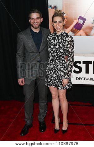 NEW YORK-DEC 8: Actors Evan Jonigkeit (L) and Zosia Mamet attend the premiere of