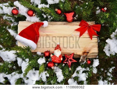 Christmas tree closeup angel red balls snow decoration wooden texture