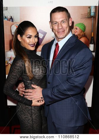 NEW YORK-DEC 8: John Cena (R) and Nikki Bella attend the premiere of