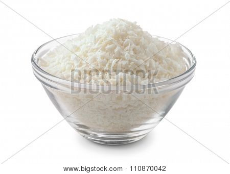 Glass bowl of coconut shavings isolated on white