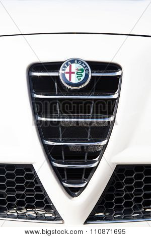 MALAGA, SPAIN - DECEMBER 2, 2015: Alfa Romeo car logo in the front grid. Alfa Romeo Automobiles S.p.A. is an Italian car manufacturer, famous because of the beautiful designs of cars.