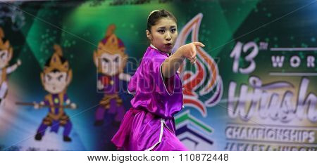 JAKARTA, INDONESIA - NOVEMBER 14, 2015: Ayaka Honda from Japan performs the movements in the women's Changquan event in the 13th World Wushu Championship 2015 held in Istora Senayan, Jakarta.