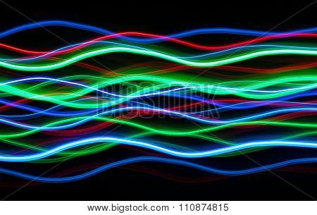 Colorful Christmas LED lights blur lines.