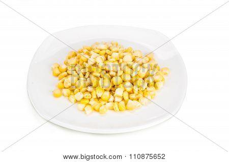 Fresh Maize Corn Kernels On Plate Against White Background