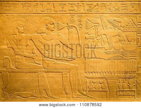 Ancient egyptian hieroglyph containing human figures