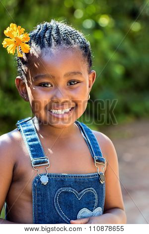 Cute African Girl With Flower In Hair.