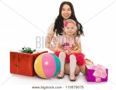 Two girls with boxes for gifts