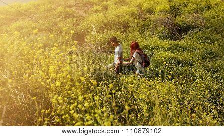 Couple Hiking On A Peak