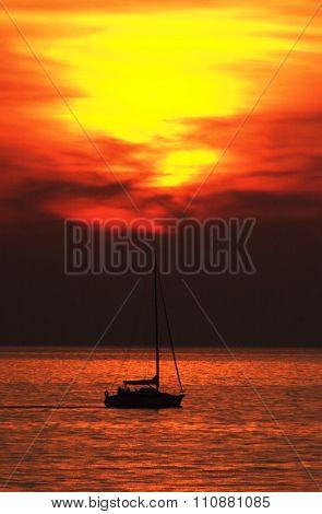 Sail bot at sunset