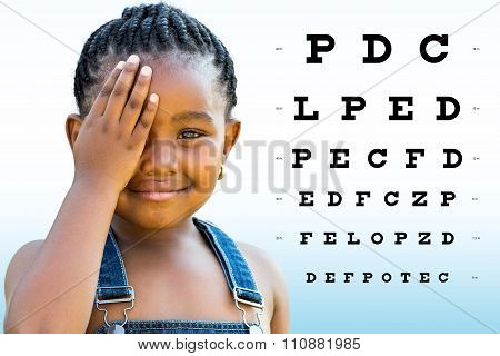 Little African Girl Testing Eyesight.