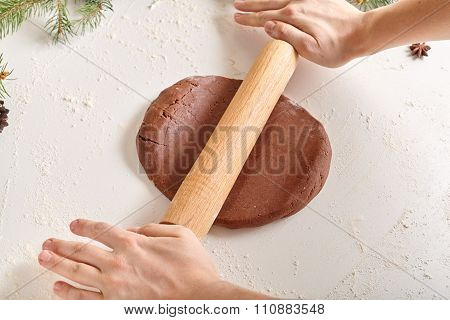 Gingerbread cookies preparation recipe, unrecognizable woman hands making dough with rolling pin on