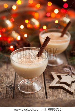 Eggnog traditional christmas egg, vanilla non alcohol liqueur preparation recipe in two glass cups w