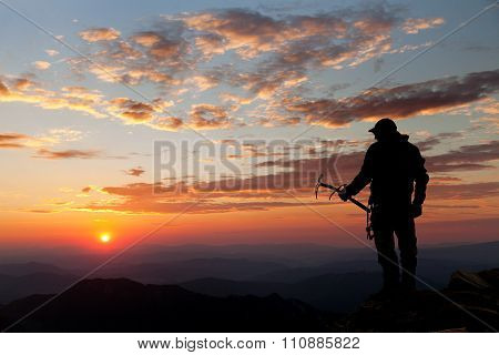 View Of Man On Mountains With Ice Axe In Hand