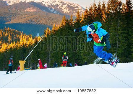 Snowboarder Jumping At Ski Resort