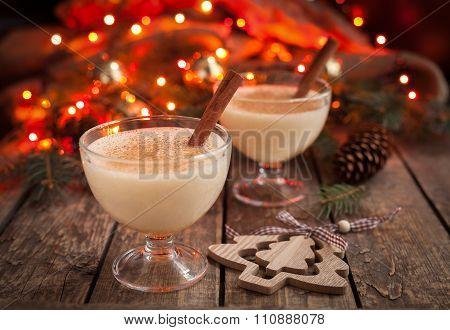 Eggnog traditional christmas egg, vanilla rum alcohol drink liqueur preparation recipe in two glass