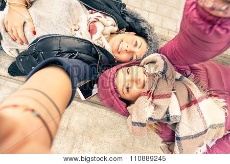 Top View Of Hipster Girlfriends Taking Selfie - Friendship Concept With Modern Technology