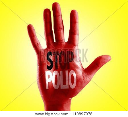 Stop Polio written on hand with yellow background