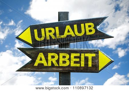 Vacation - Work (in German) signpost with sky background
