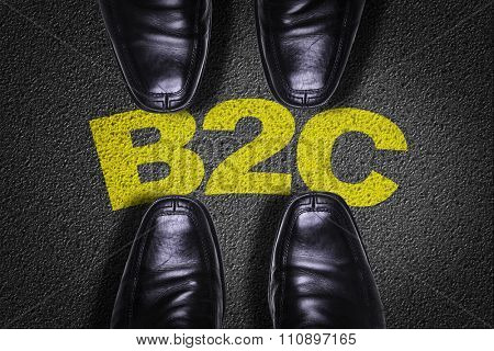 Top View of Business Shoes on the floor with the text: B2C