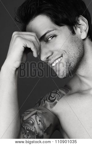 tattooed guy smiling