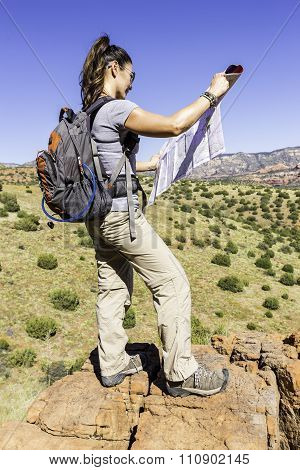 Woman Using Map During Hike