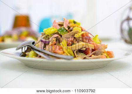 Dish of salad.