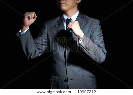 Handsome man in business suit is happy with success