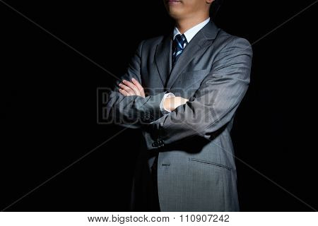 Businessman with arms crossed in front