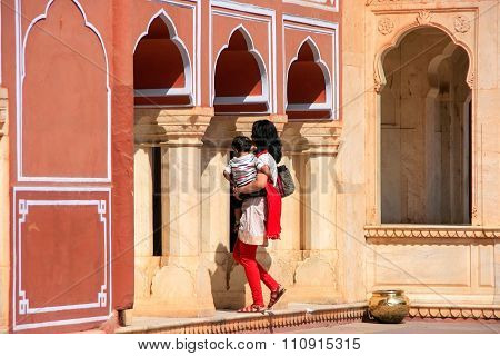 Jaipur, India - February 27: Unidentified Woman With Child Walks In Chandra Mahal On February 27, 20