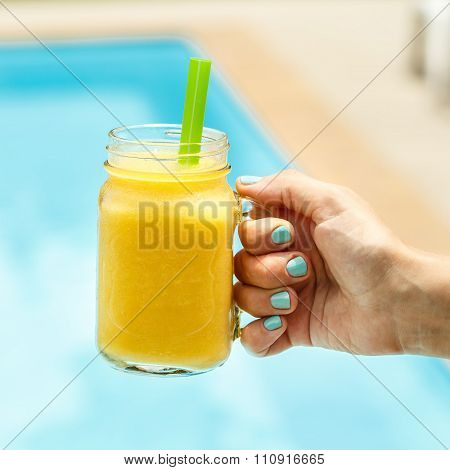 Fruit Smoothie - Healthy Eating Concept. Close Up Of  Detox Smoothie With Mango. Woman Hand Holding
