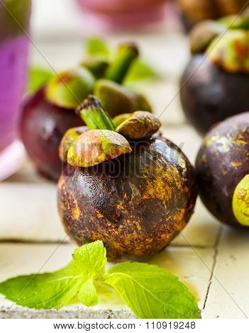 Mangosteen With Mint Leaves On A White Table