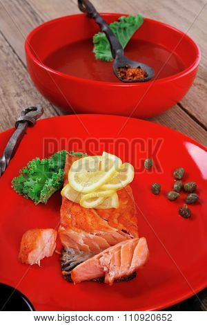 delicious portion of fresh roast salmon fillet red plate with green salad kale tomato soup bbq sauce and black coffee over wooden table - healthy food, diet cooking concept kale tomato soup bbq sauce