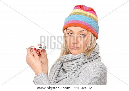 Ill Woman With Thermometer In Her Hands