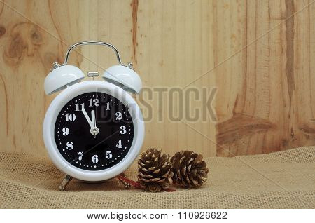 Alarm Clock With Pinecones Background