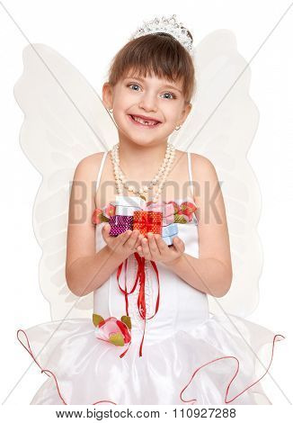 lost tooth child dressed as tooth fairy with little gifts