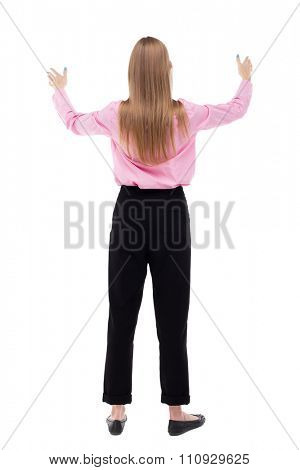 Back view of  business woman.  Raised his fist up in victory sign.    Raised his fist up in victory sign. Isolated over white background. The girl office worker in black trousers praying