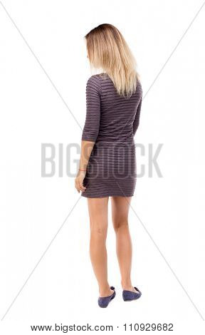 back view of standing young beautiful  woman.  girl  watching. Rear view people collection.  backside view of person.  Isolated over white background. Girl in a short dress is looking to the left.
