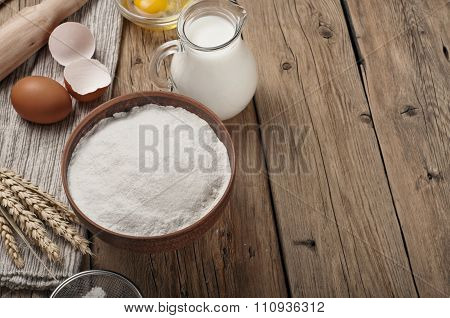 Flour, Egg, Milk On Wooden Table Rustic Kitchen